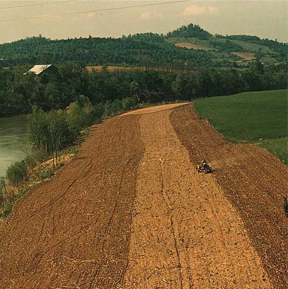 Planting corn alog a river in northeastern Tennessee