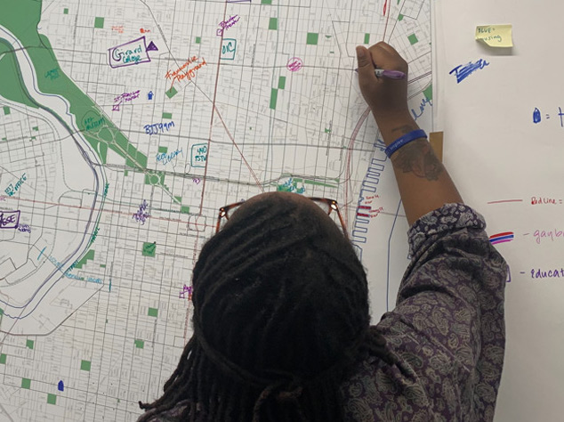 student drawing on map