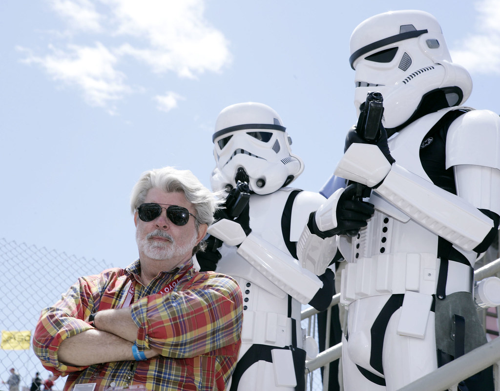Photograph of George Lucas with Droids in Background