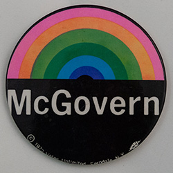 Black with a rainbow over McGovern in white