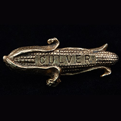 Ear of corn with Culver stamped, made of brass