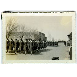 Photograph of women in uniform marching on UNI campus