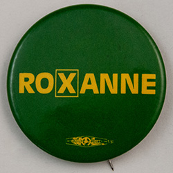 Green with text. Roxanne with a box around the x.