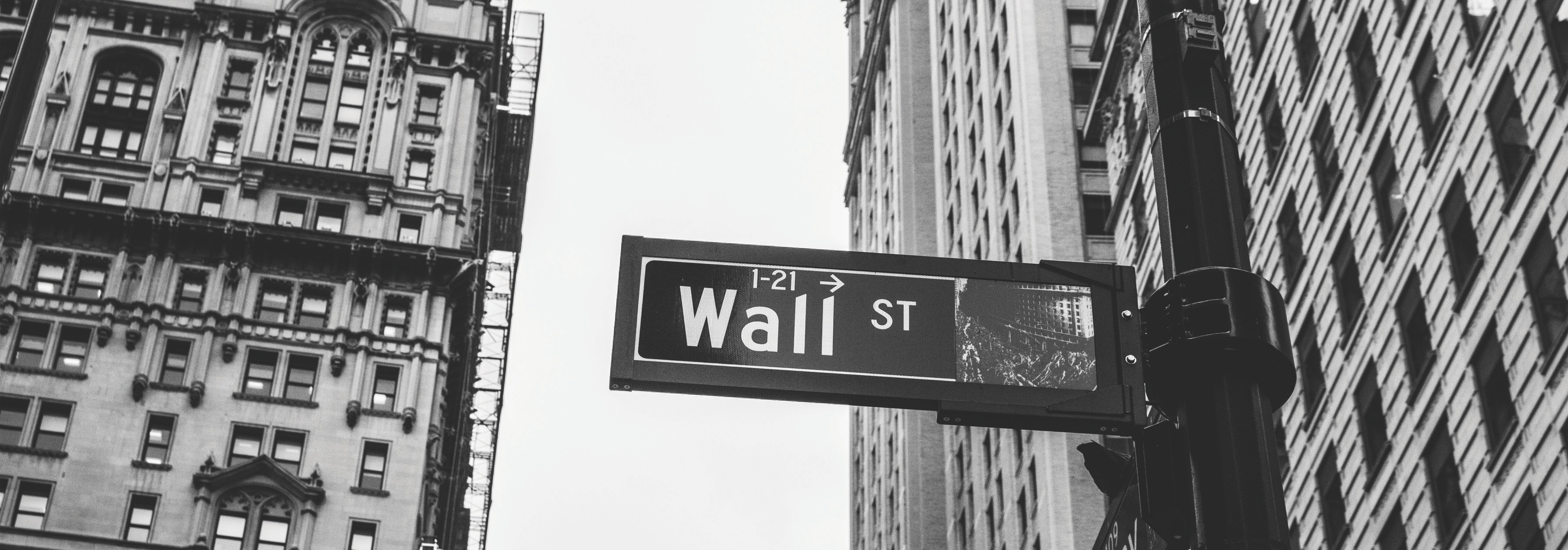 decorative image of Wall St. in NYC