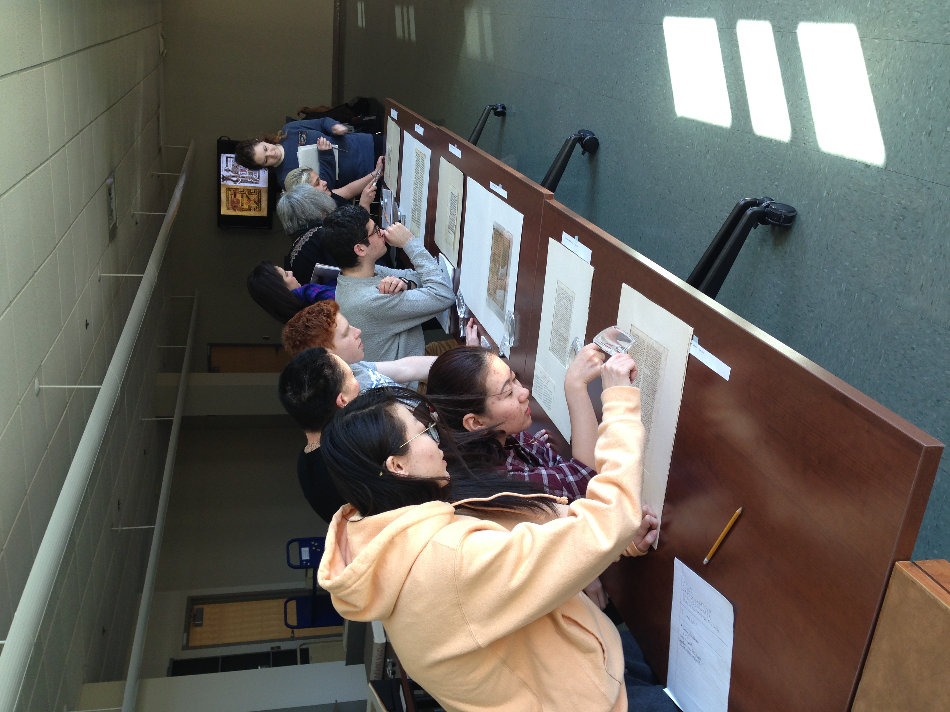 Students study medieval manuscript fragments
