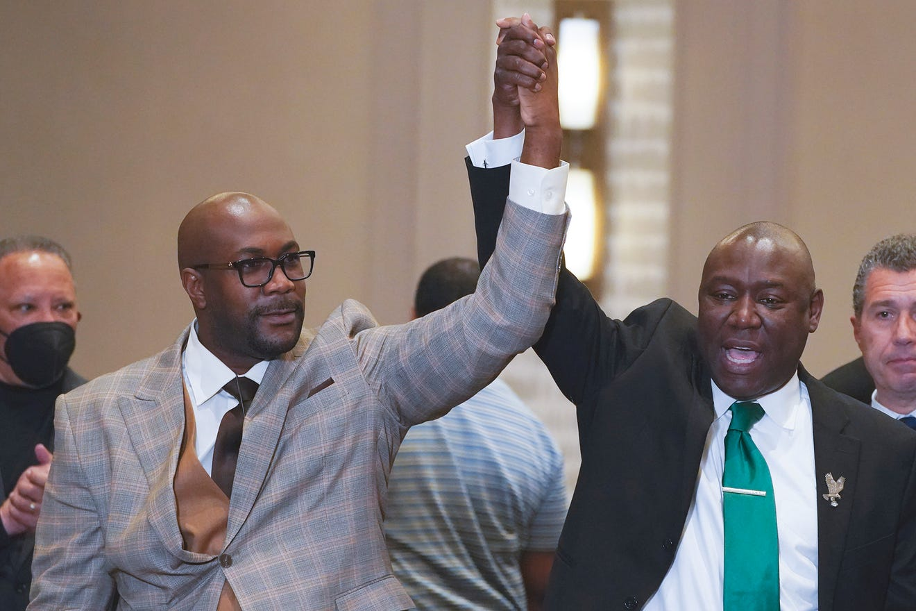 Philonise Floyd and attorney Ben Crump celebrate the guity verdicts for Derek Chauvin, April 20, 2021.