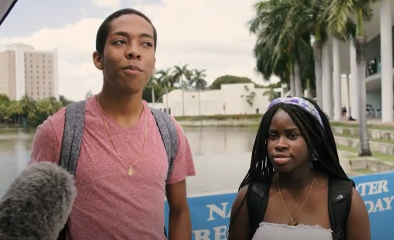 Two college students are interviewed about voting