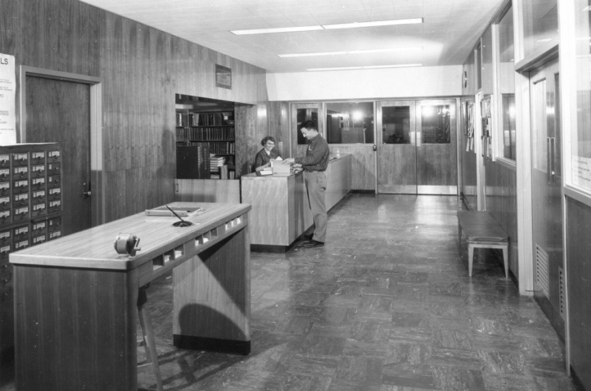 Library circulation desk and card catalog in Schurman Hall, 1960