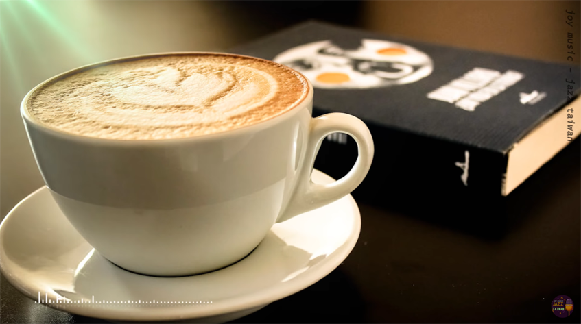 Cappuccino cup and book on a table