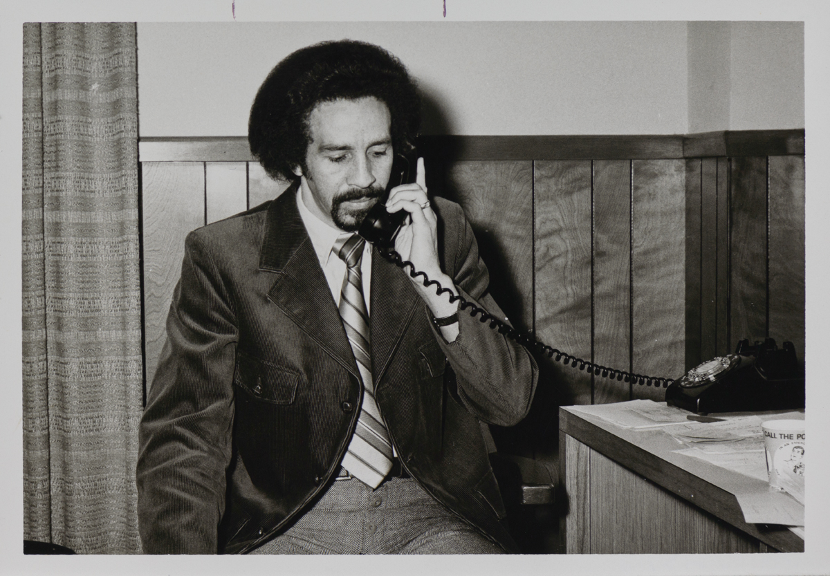 Odell Johnson, Dean of Students, talks on phone in 1970