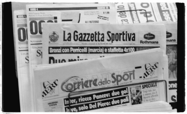 Black and white photograph of Italian newspapers