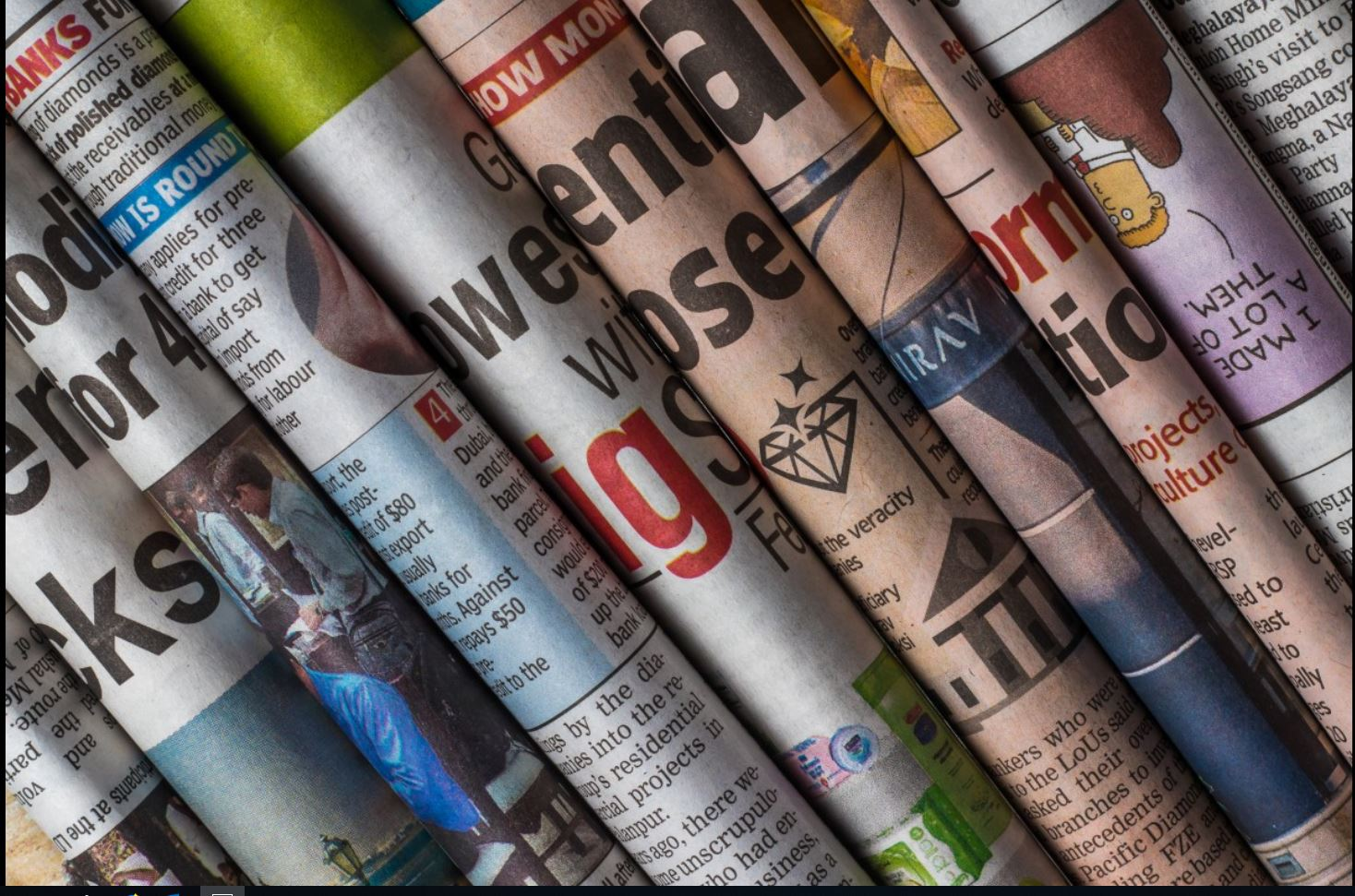 Decorative Image: Stacked Newspapers