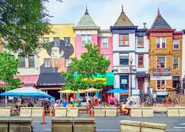 Adams Morgan commercial area, showing storefronts and restaurants with outdoor seating due to Covid-19.