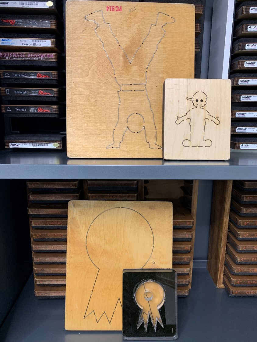 Pictures of dis cuts in the Education Library with two sizes, boy and award pictured here