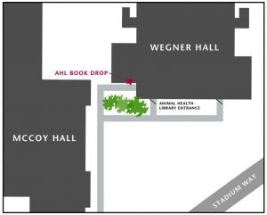 Outline of Wegner Hall next to Mccoy Hall with book drop labeled around corner and behind trees from main entrance