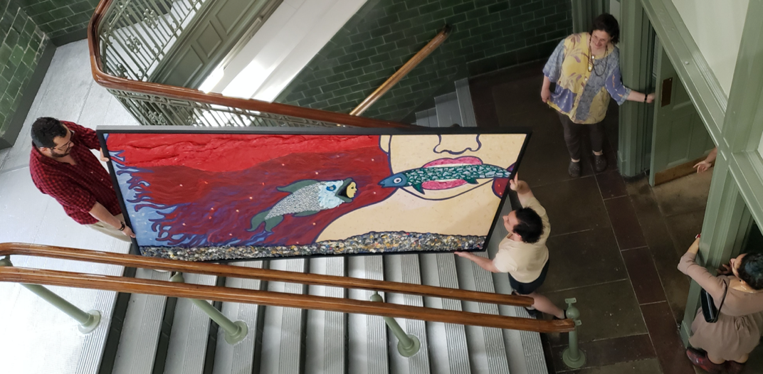 Painting by Christine Stoddard en route to installation in Shepard Hall, photograph by Andrea Cadornigara.