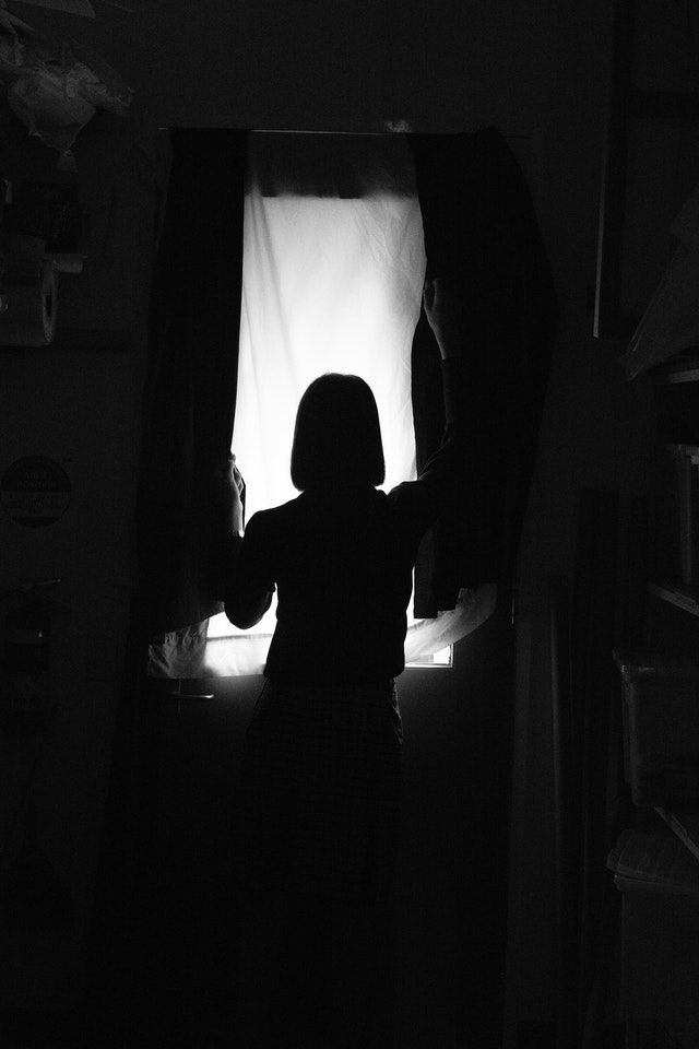 Silhouette of person at a window