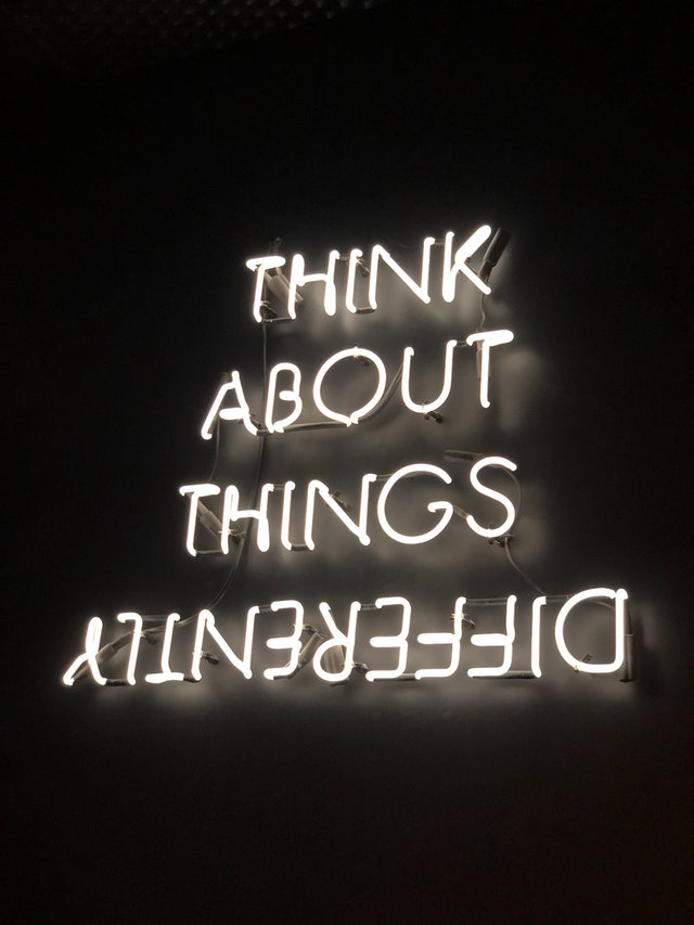"image with text displaying ""think about things differently, with differently upside down"""