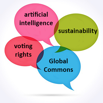 Image of four speech bubbles saying artificial intelligence, sustainability, voting rights, and global commons.