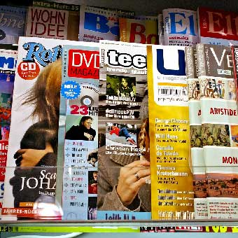 Photo of 12 magazine covers.