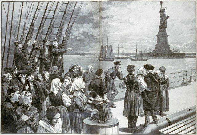 Immigrants standing on deck of a ship.