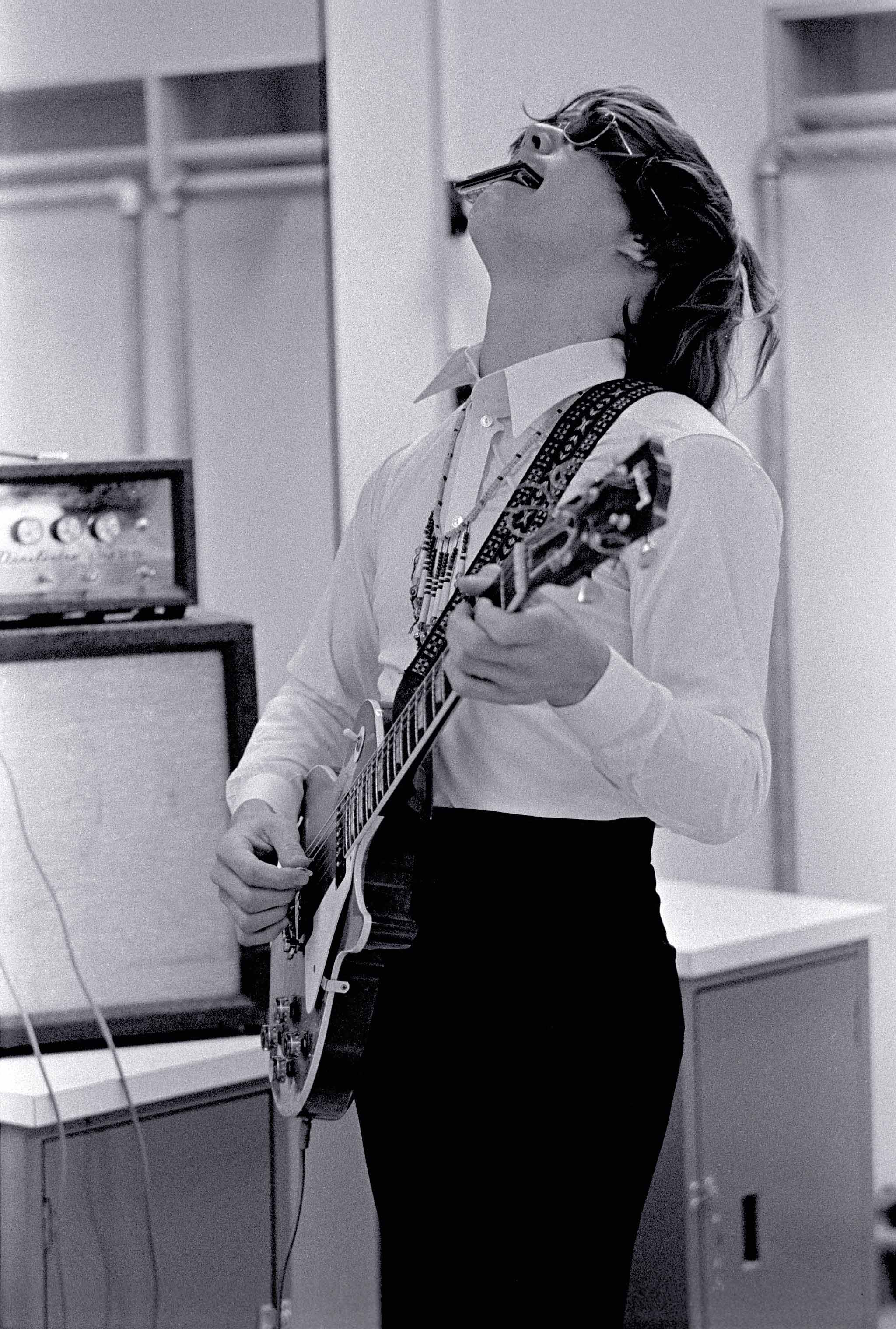 Steve Miller playing guitar and harmonica