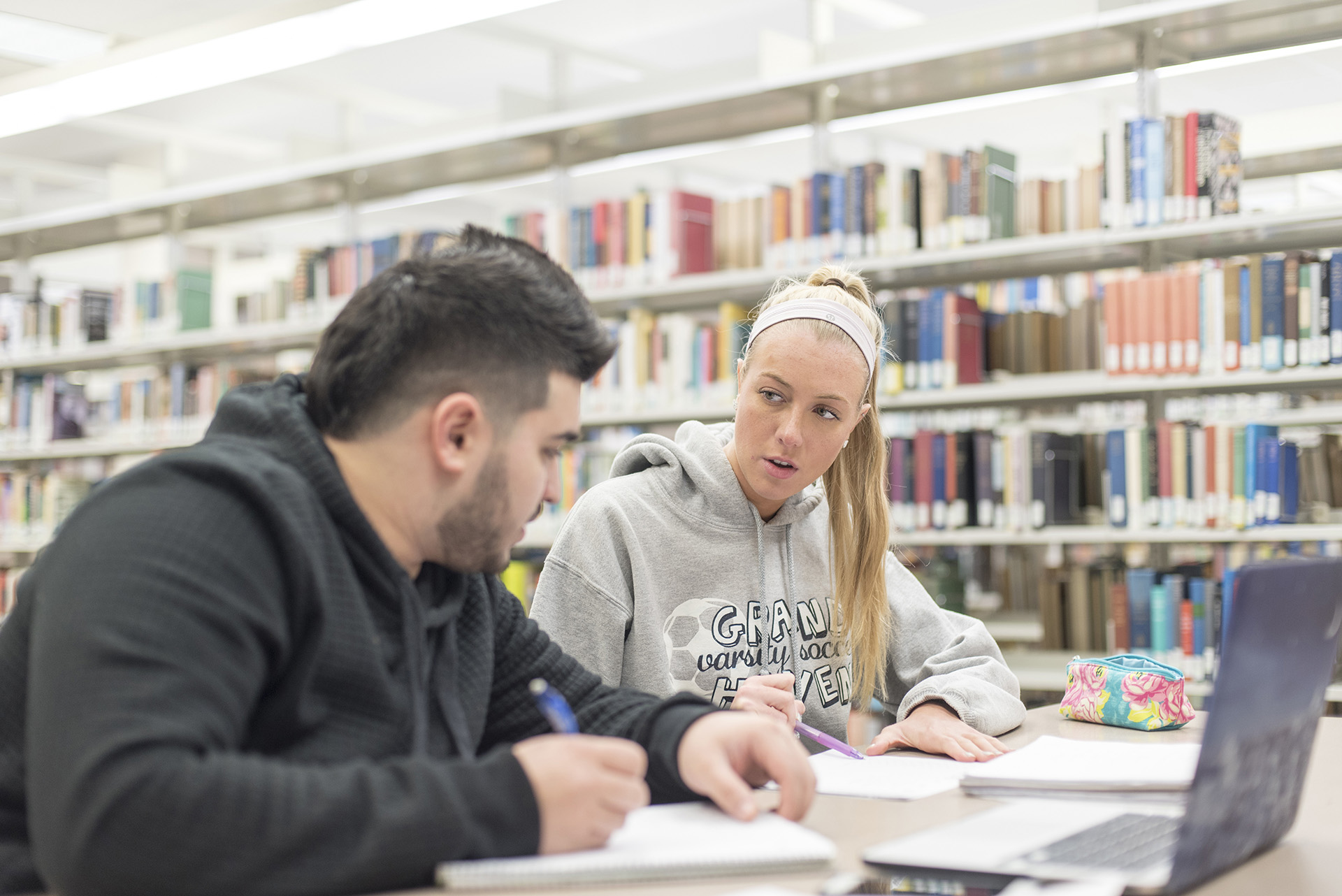 Two students study together at Delta Library.