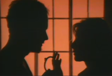 Silhouette of two people in front of window