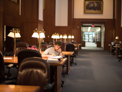 A student studies in the Caplin Reading Room