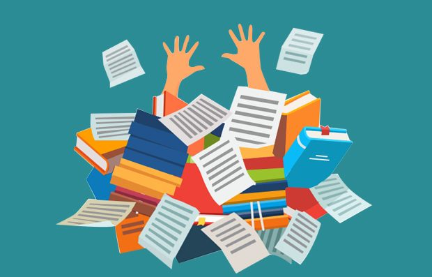 image of a student drowning in articles and books.