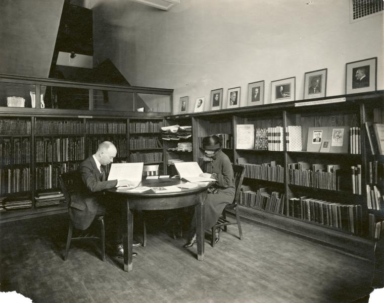 Patrons reading in the library.