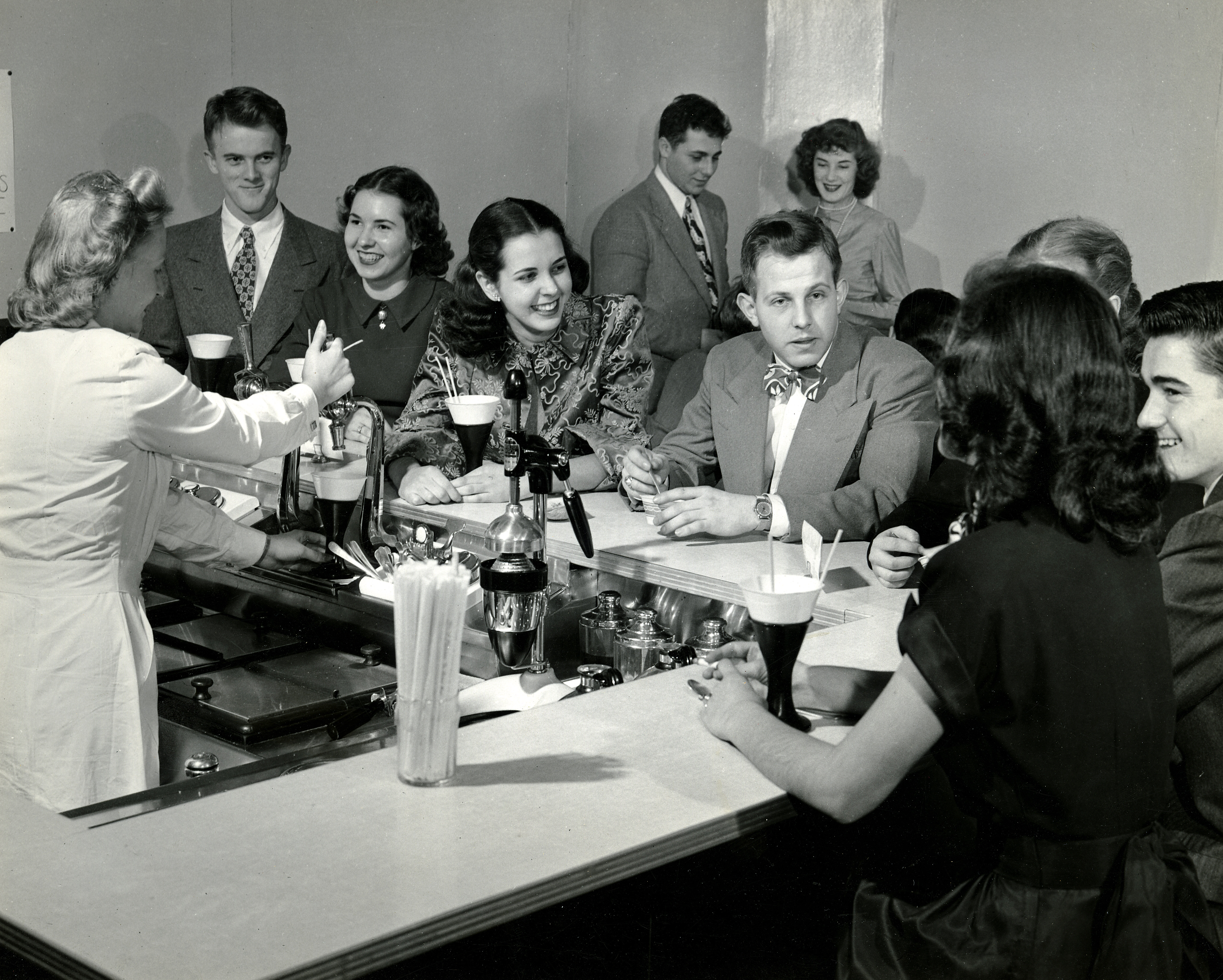 Men and women at a soda shop counter
