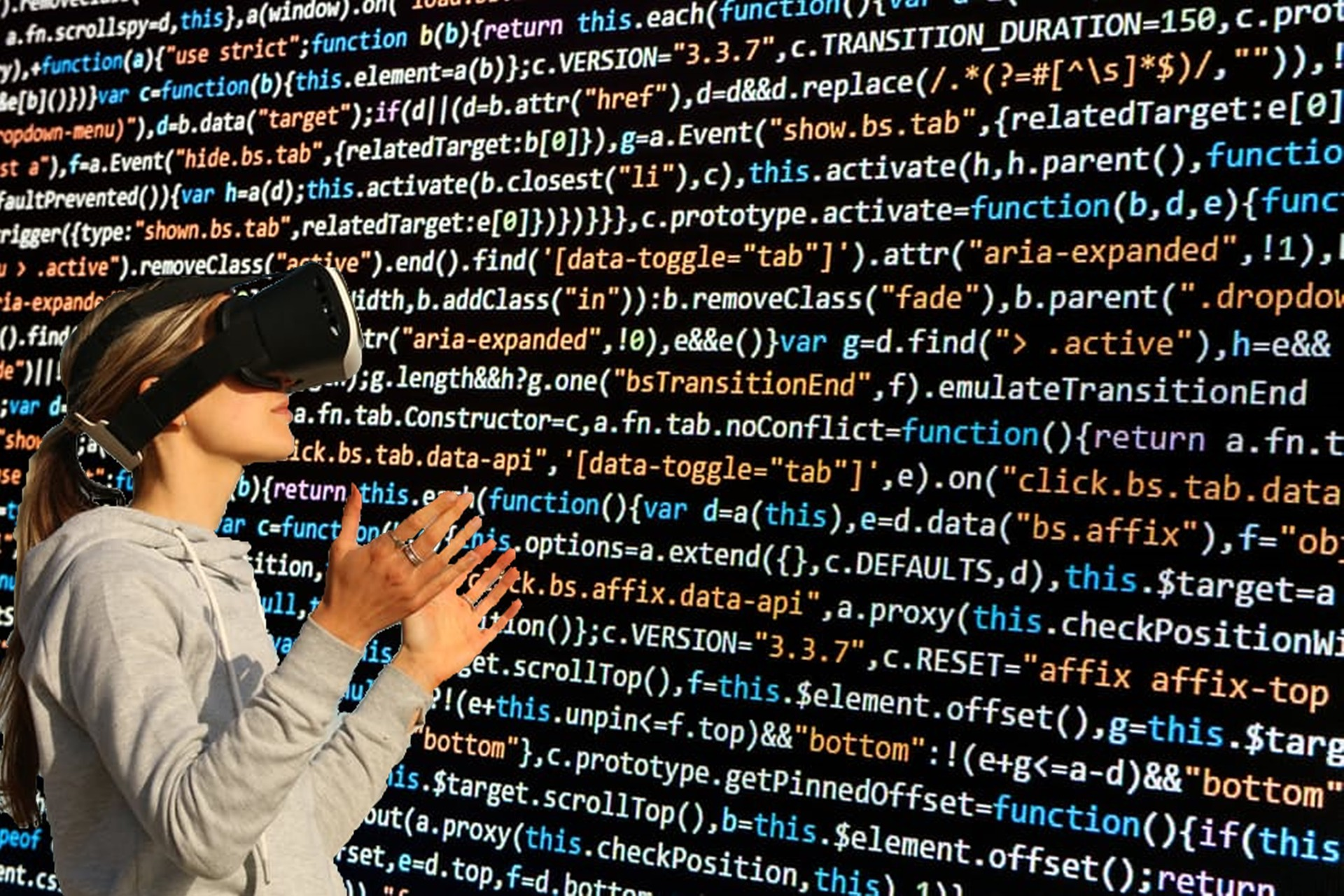 woman in VR glasses looks at computer code