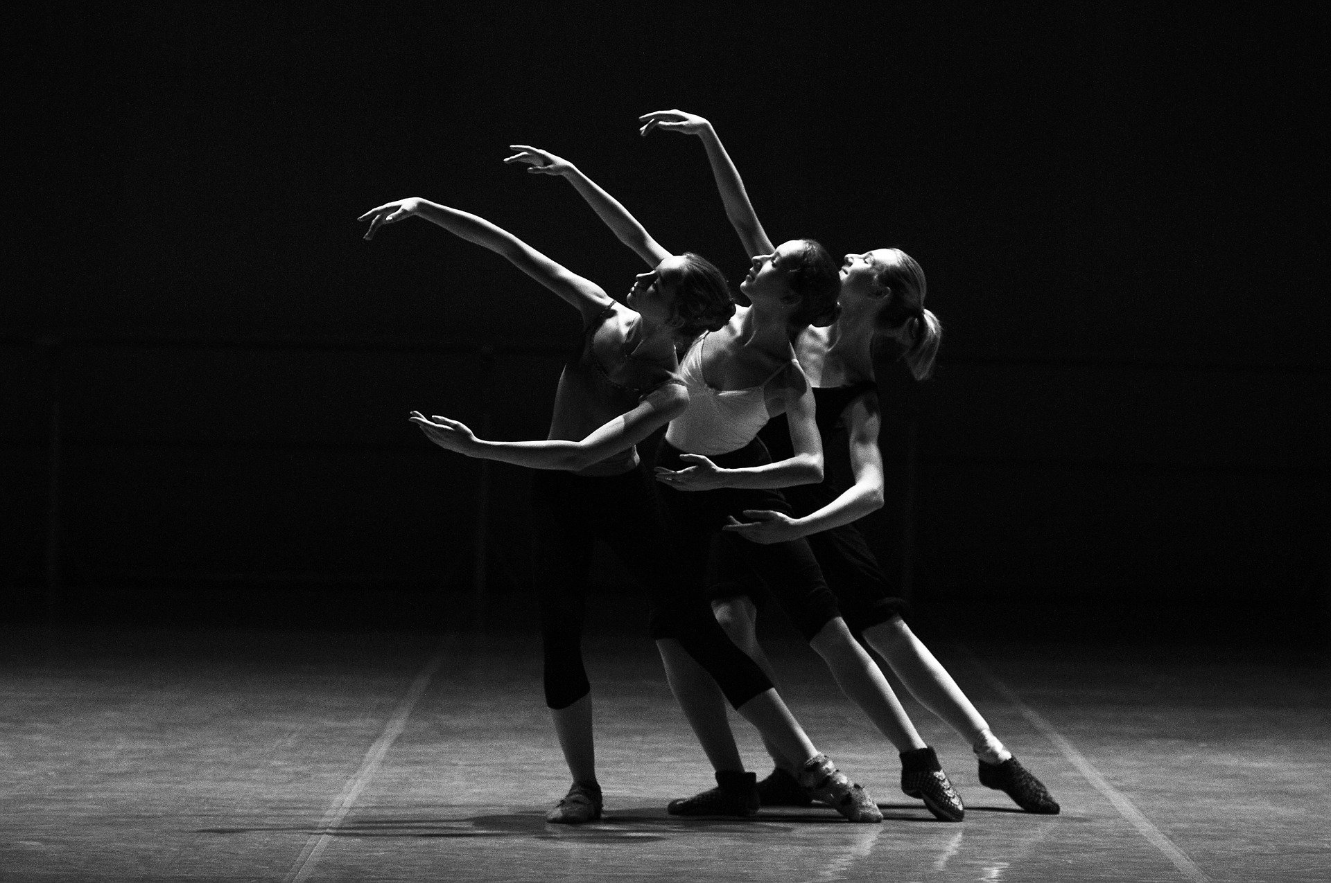 black and white image of three women in dance pose