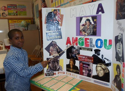 Boy with poster presentation on Maya Angelou