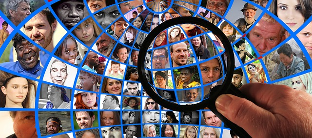 Magnifying glass over images of people from around the world.