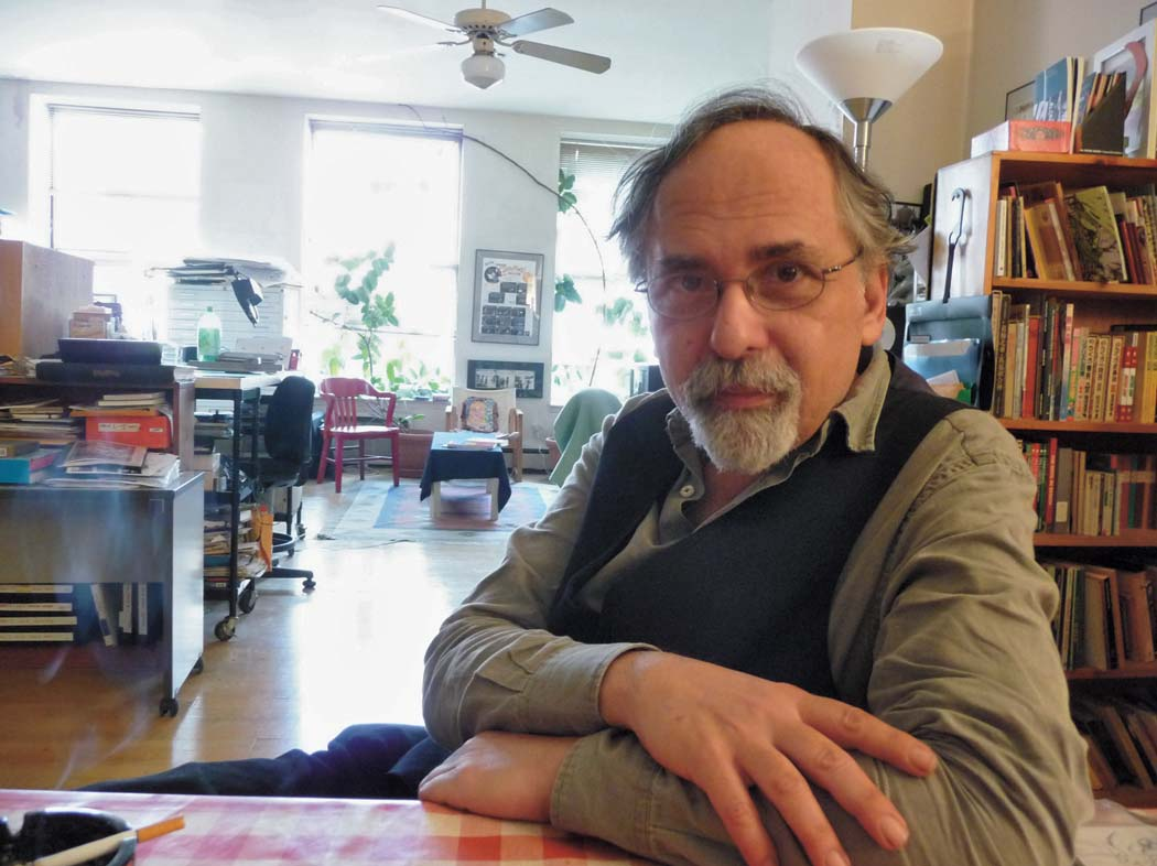 A photo of author Art Spiegelman sitting in a sunny room
