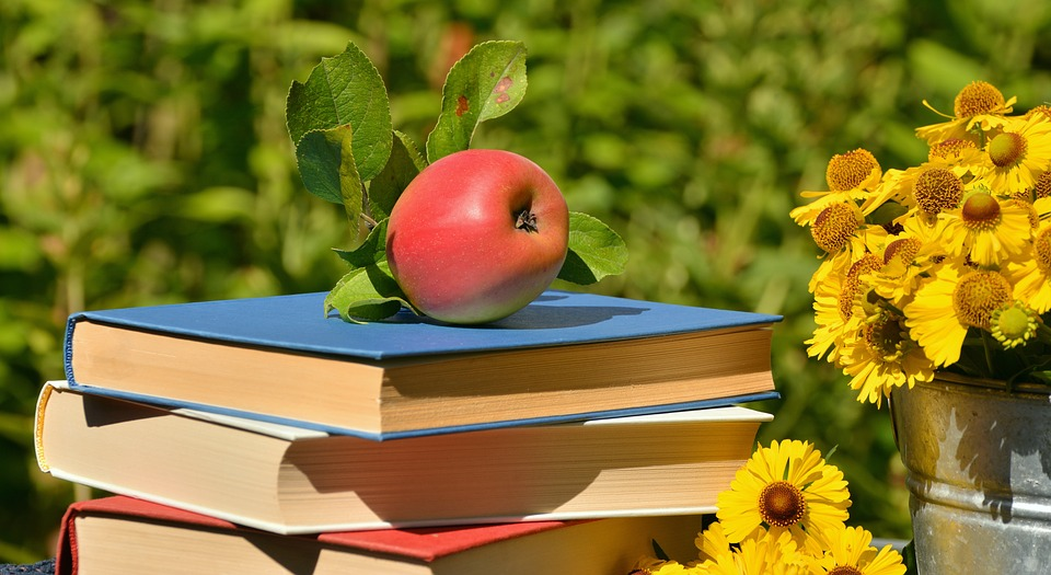 Books, apple and flowers