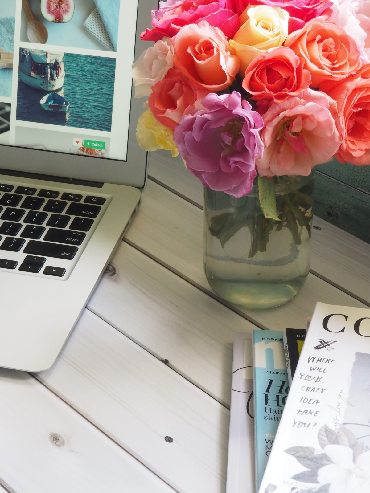 Laptop, flowers and magazines