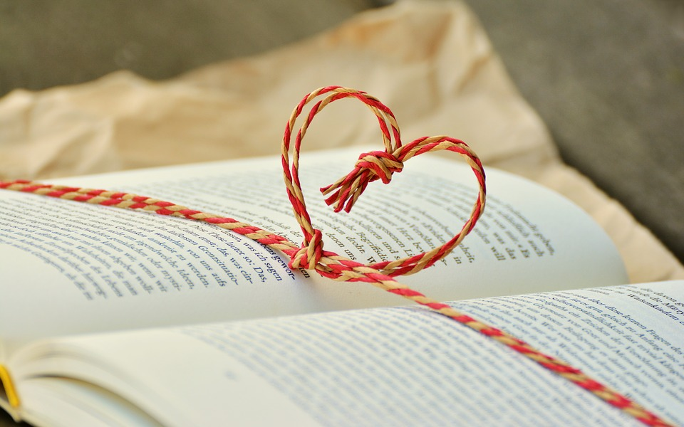 Open book with heart tied from string