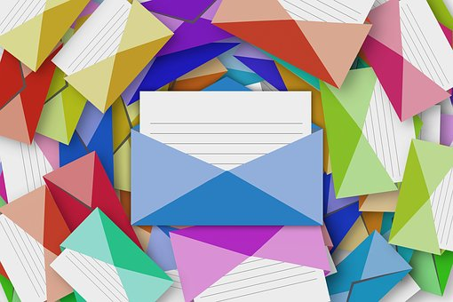 Colorful envelopes filled with blank cards fill the entire image.