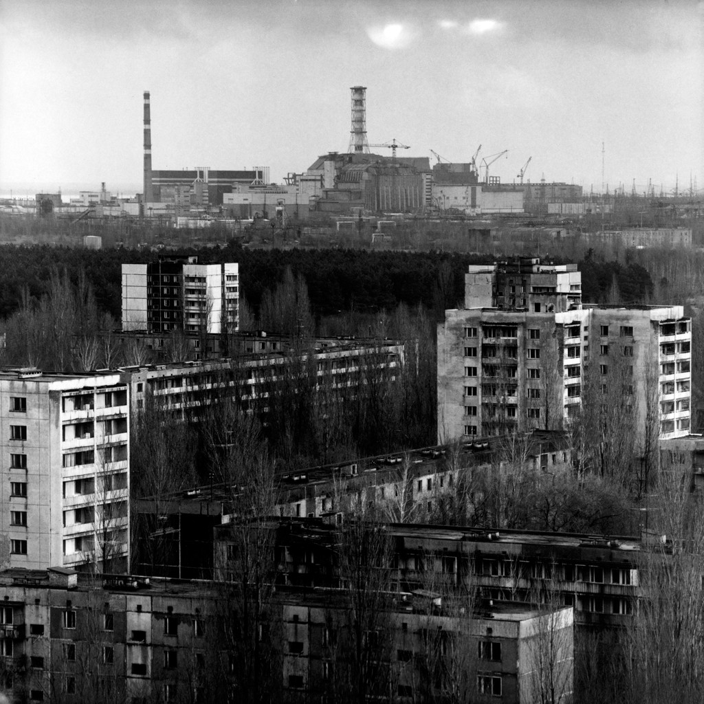The town of Pripyat with the Chernobyl nuclear plant in the background.