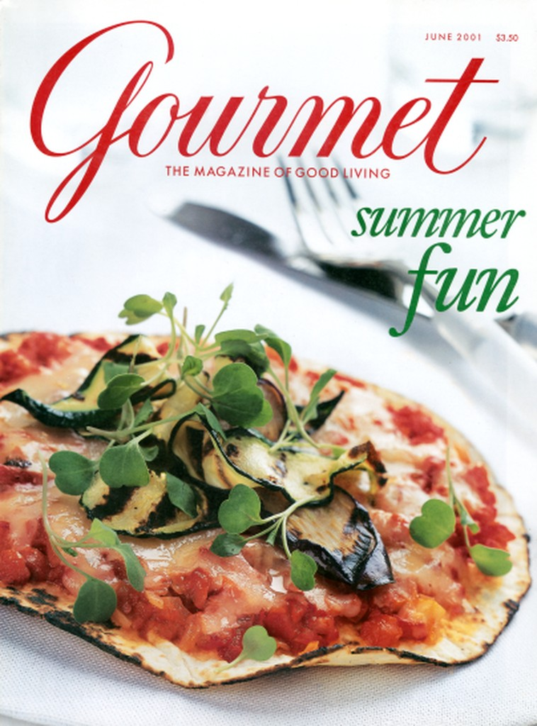 Pizza on a white napkin. Summer Fun issue Publication: Gourmet