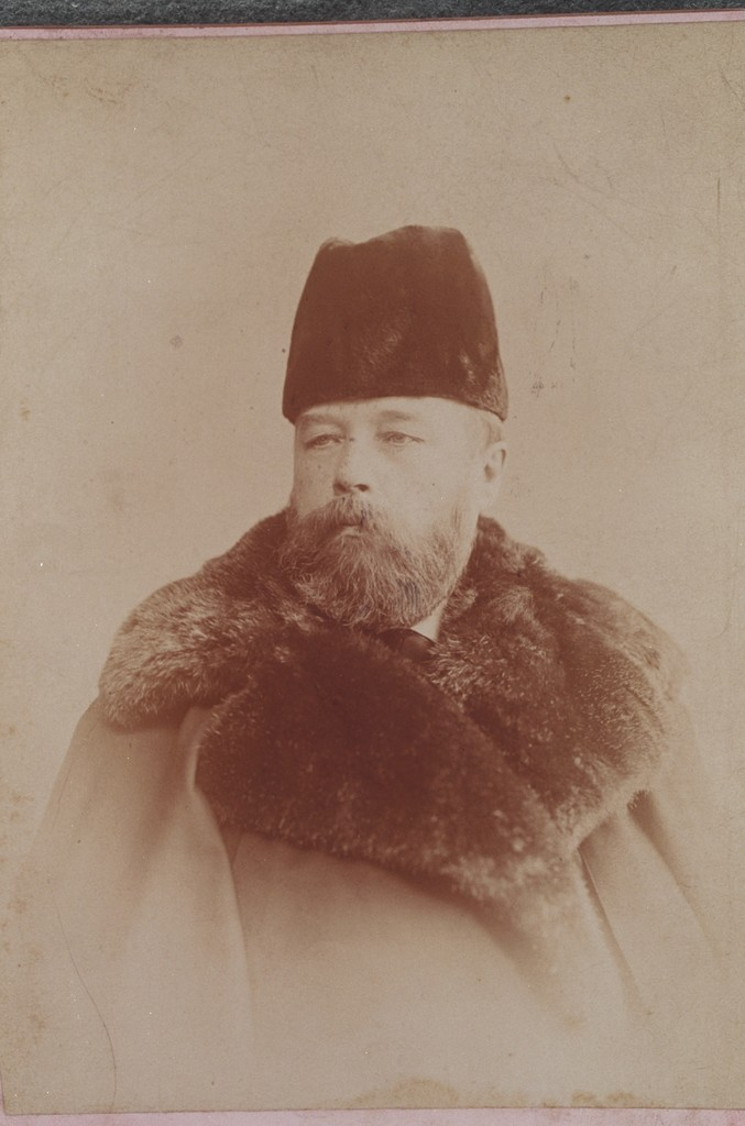 Portrait of a Russian man in a coat with a heavy fur collar and fur hat.