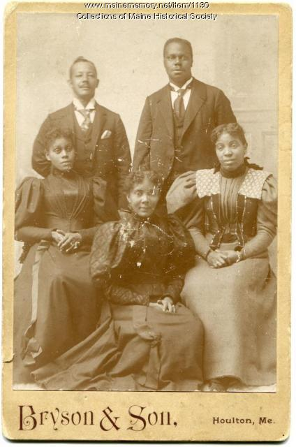 19th century African American family posing for portrait.