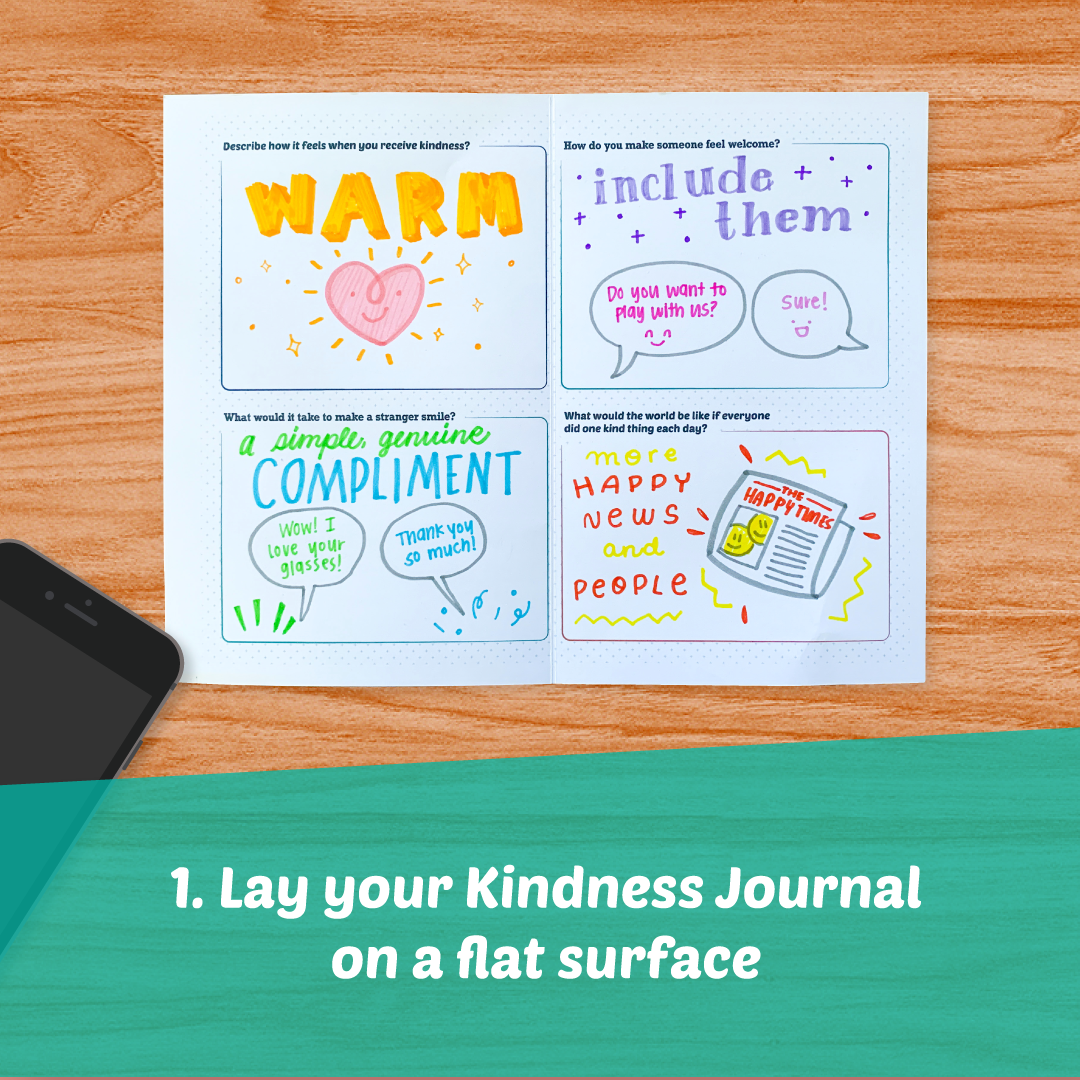 Lay your Kindness Journal on a flat surface