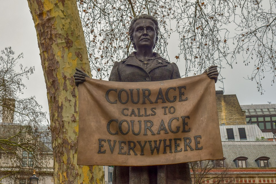 "Statue of a women holding a message ""courage call to courage everywhere"""