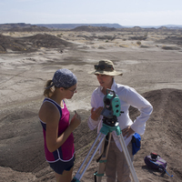 Women In Science and Engineering image from online exhibition - two women talking in a desert