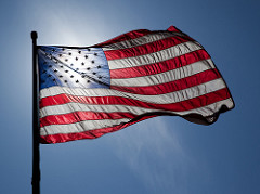 Image of the United States flag in sunny sky