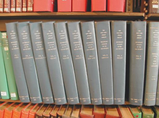 Image of spines of several volumes of the Dictionary Catalog of the Map Division on the shelf in the NYPL Map Division